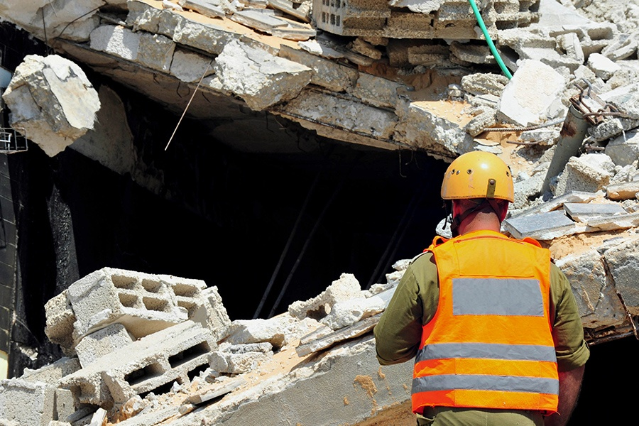 Commercial Earthquake Insurance - Closeup of a First Responder and Rubble at the Location of a Commercial Earthquake Disaster