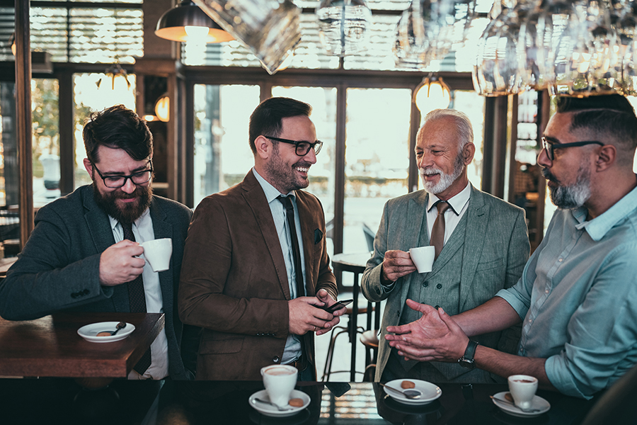 Fraternal Organization Insurance - Group of Club Members Organizing and Discussing Details Over Coffee at a Bar at the Lodge